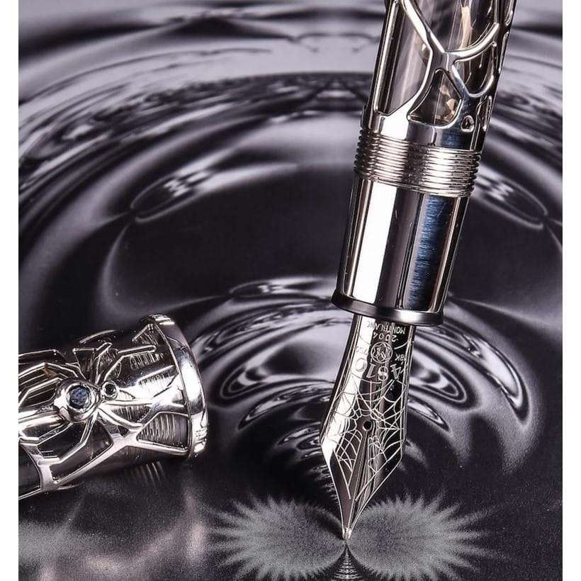 Inline Image - Magical Black Widow, 88, limited edition white gold coloured skeleton fountain pen, no. 09/88, circa 2004, stamped 750, the cap with a spider clip set with two black diamonds and a mother of pearl emblem, the medium nib stamped 18K 750, piston filling system, uninked, est. £8,000-12,000