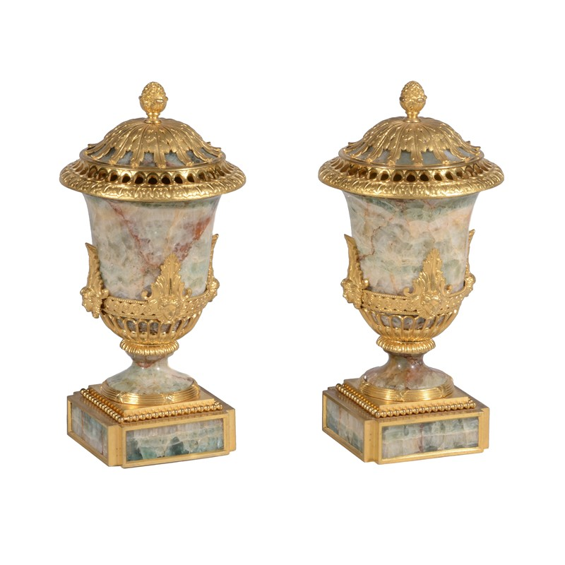 A pair of ormolu and green fluorspar perfume vases and covers, 19th century
