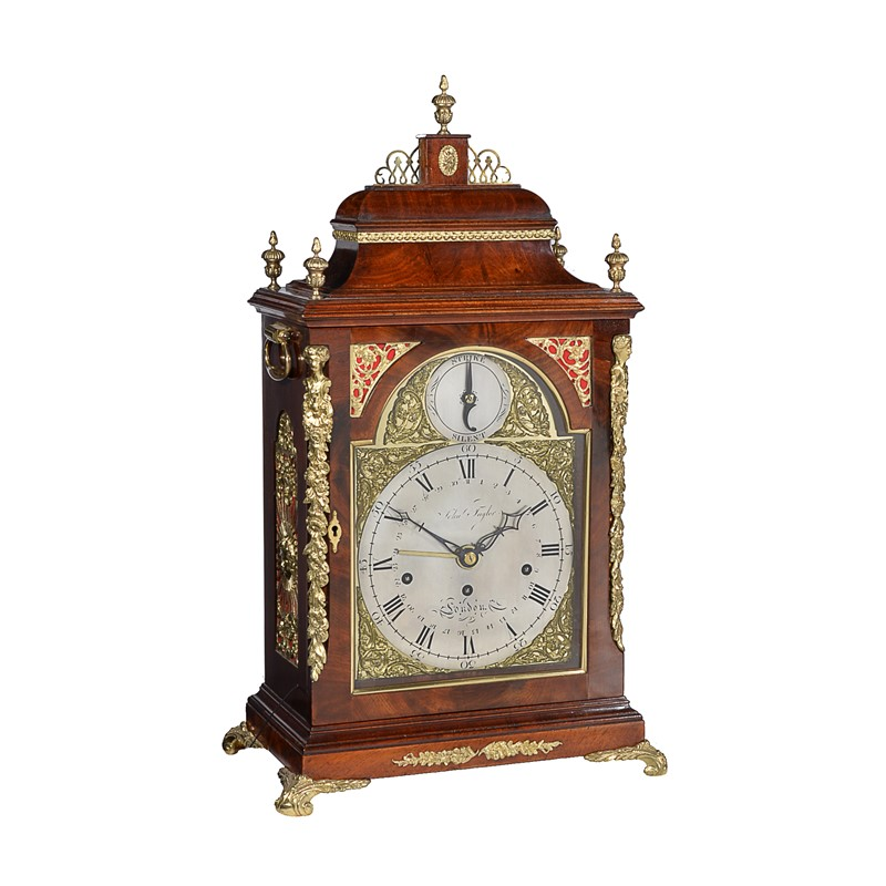 A fine George III brass mounted mahogany quarter-striking table clock