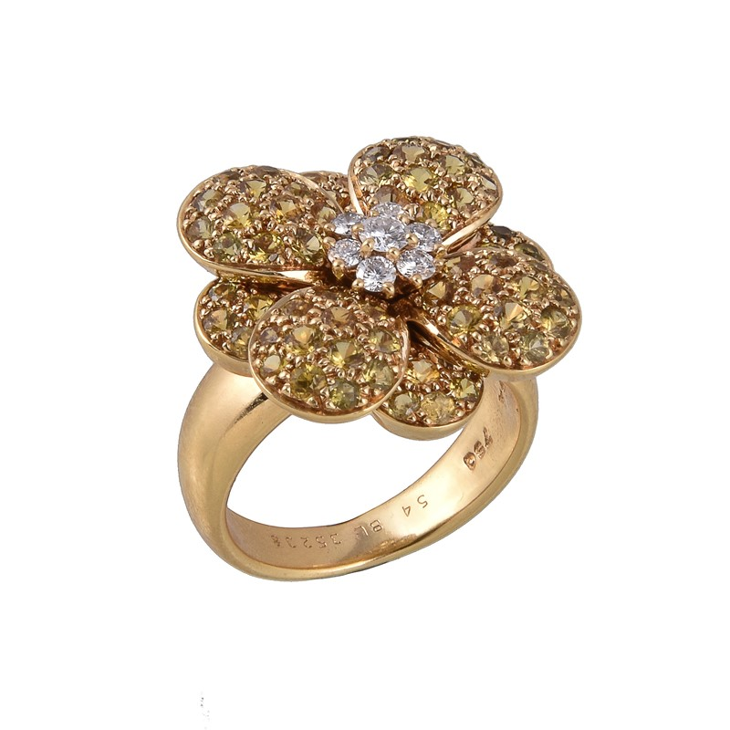 A diamond and yellow sapphire flower ring by Van Cleef & Arpels