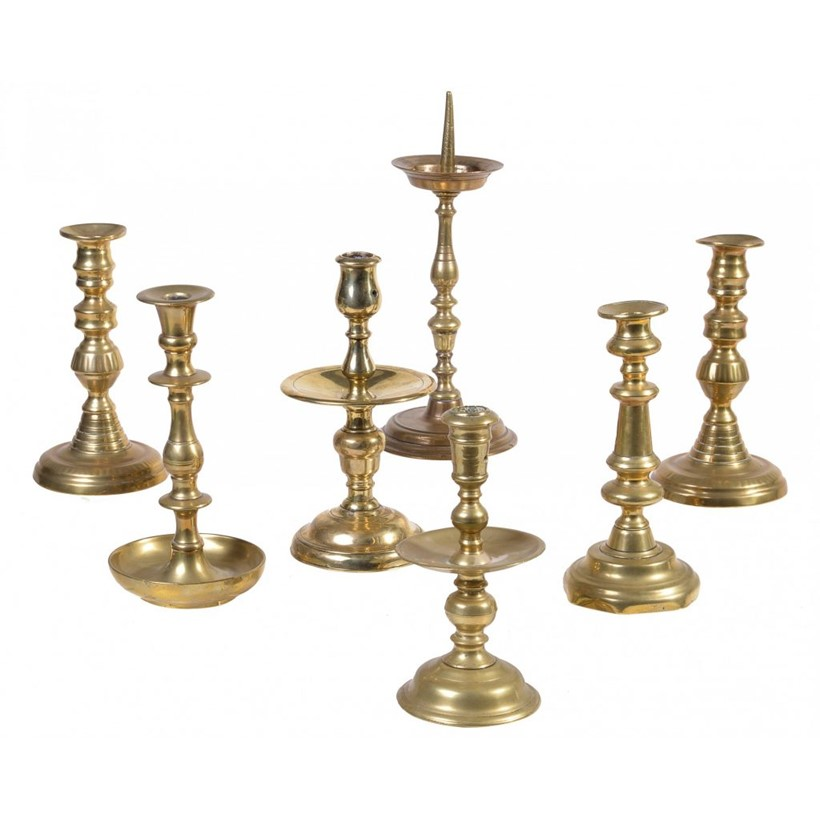 Inline Image - A Dutch brass 'Heemskerk' type candlestick, late 17th century | Similar Dutch brass candlestick | A German or Netherlandish brass pricket candlestick, probably 17th century | A pair of Victorian brass candlesticks, mid-19th century | A brass candlestick in 17th century Spanish style | Est. £400-600 (+fees) (Lot 421)