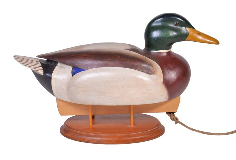Inline Image - Alan Emmett (1938-2008), a modern carved and painted wood model of a duck decoy, signed and dated to the underside 'ALAN EMMETT Feb 2006' | Sold for £400