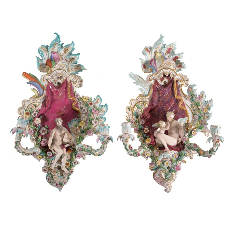 A pair of Meissen flower-encrusted allegorical two-branch wall appliques, late 19th century