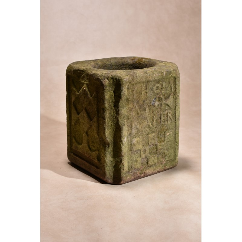 A Charles II carved sandstone mortar or vessel, dated 1675
