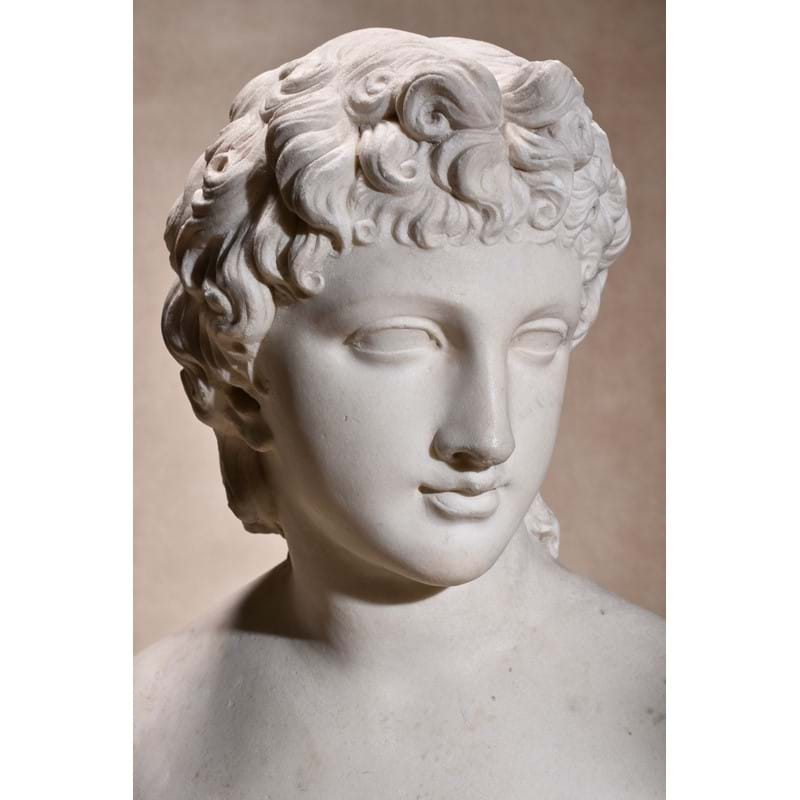 A Continental sculpted white marble bust of a youthful Apollo, late 18th / early 19th century