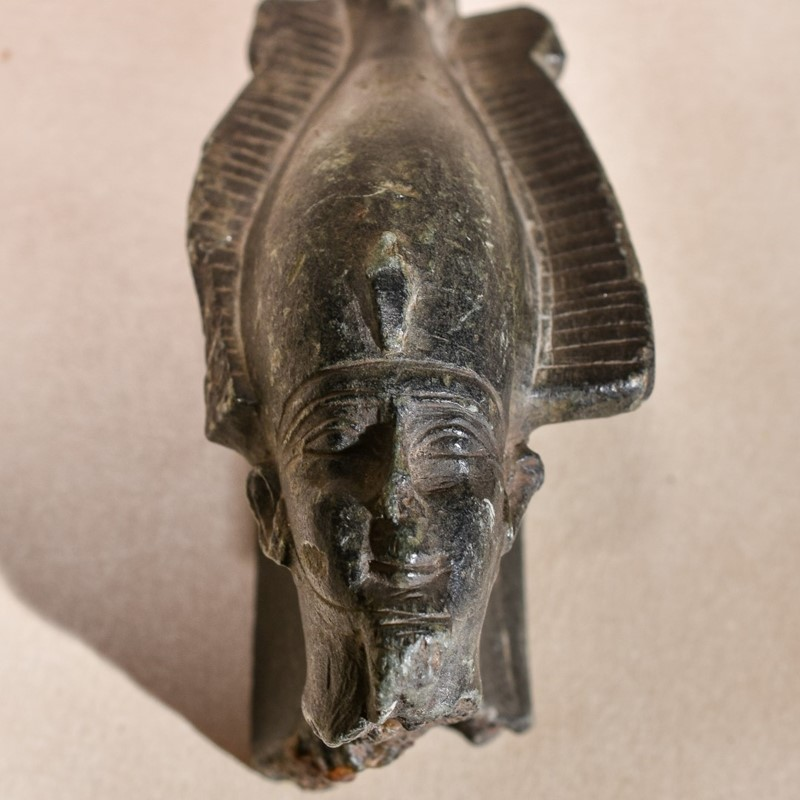 An Egyptian sculpted steatite fragment of the head of Osiris, Late Period to the Ptolemaic, circa 600-32 BC, portrayed as wearing the White Crown of Upper Egypt