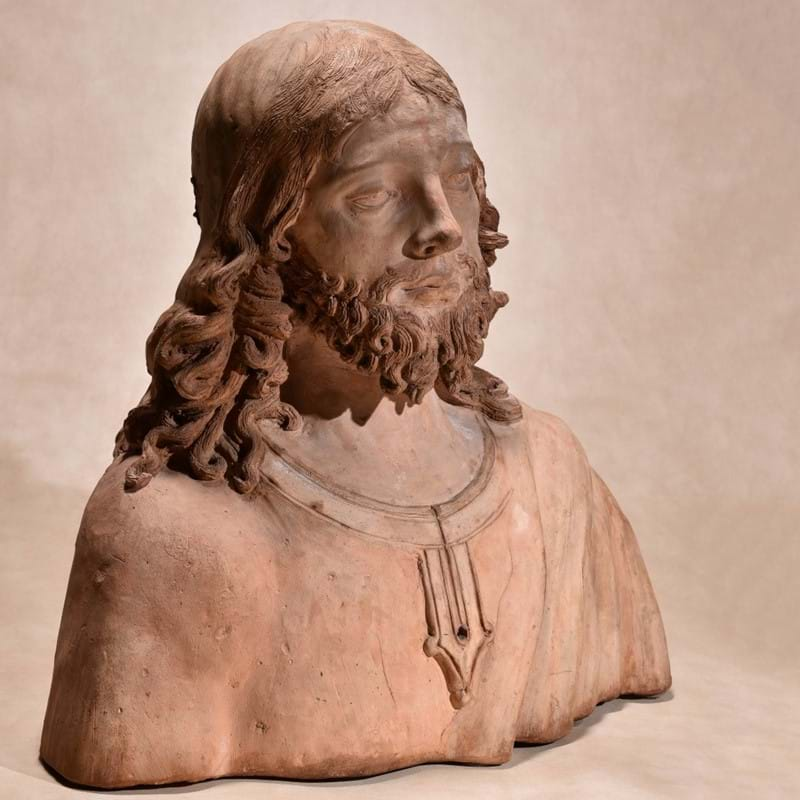 A North Italian, probably Florentine sculpted terracotta bust of Christ the Redeemer, in the manner of Andrea del Verrocchio (1435-88), late 15th / early 16th century