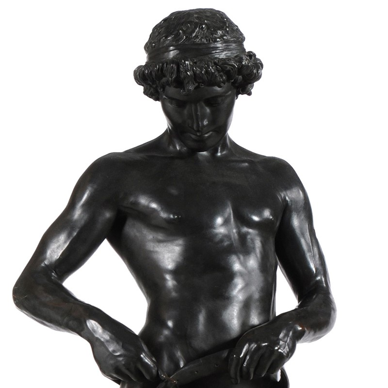 Mathieu Molitor (German 1873-1929), a patinated bronze model of a youth, 'Gürtelbinder'