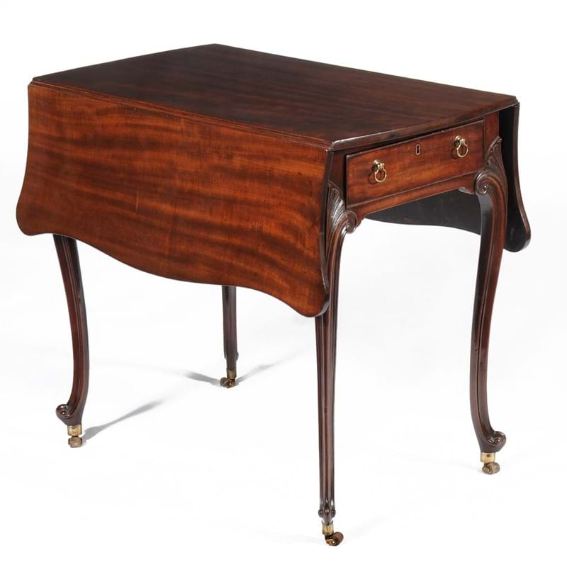 A George III mahogany 'butterfly' Pembroke table, attributed to Thomas Chippendale, circa 1770