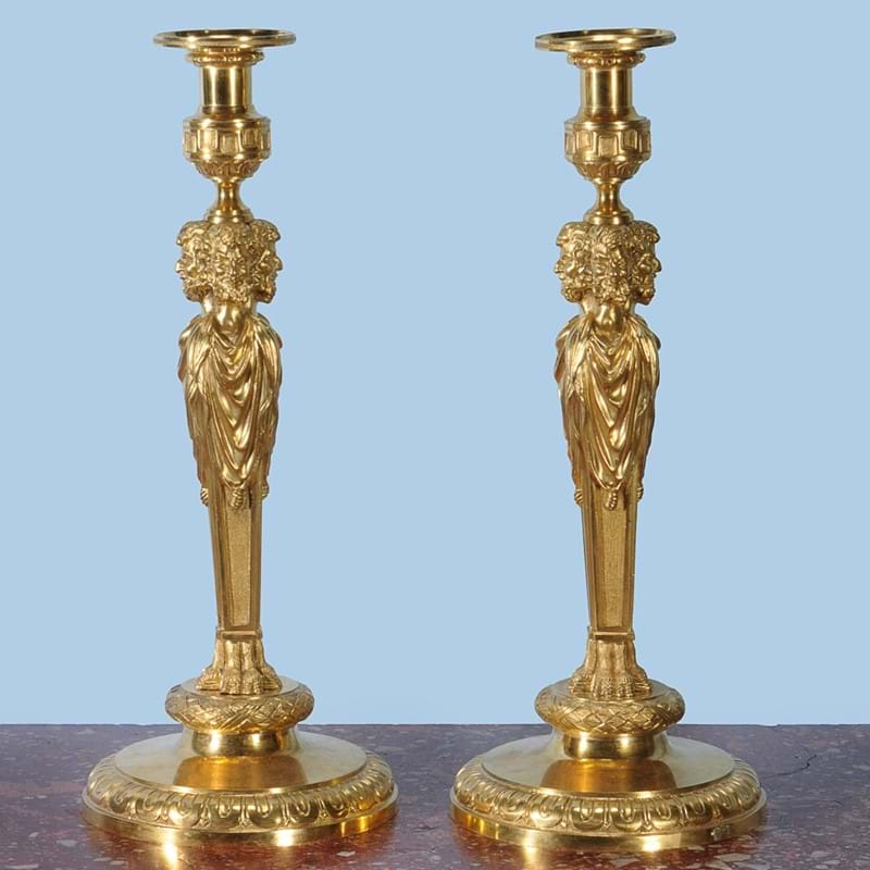 A pair of fine and substantial gilt bronze candlesticks, 19th century, in the manner of designs by Pierre Gouthière and Matthew Boulton