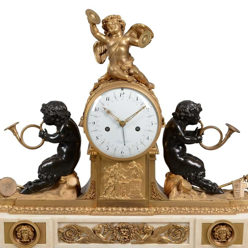 A Louis XVI gilt and patinated bronze and white marble figural mantel clock, the movement by Laurent Ridel of Paris, last quarter 18th century