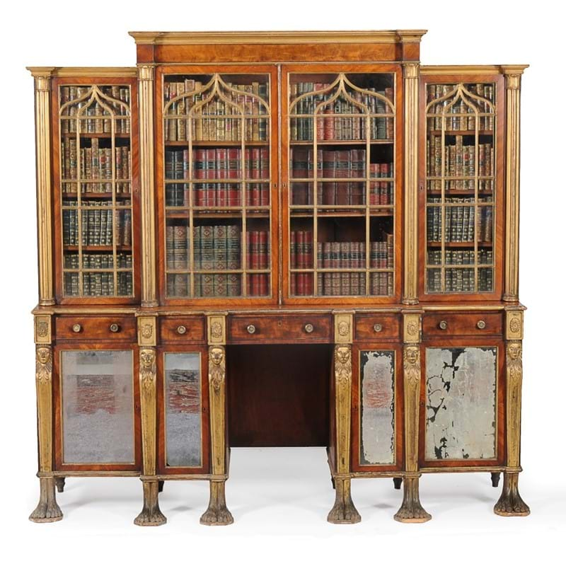 A Regency mahogany and parcel gilt breakfront library bookcase, circa 1815; provenance: Private Collection, Gloucestershire