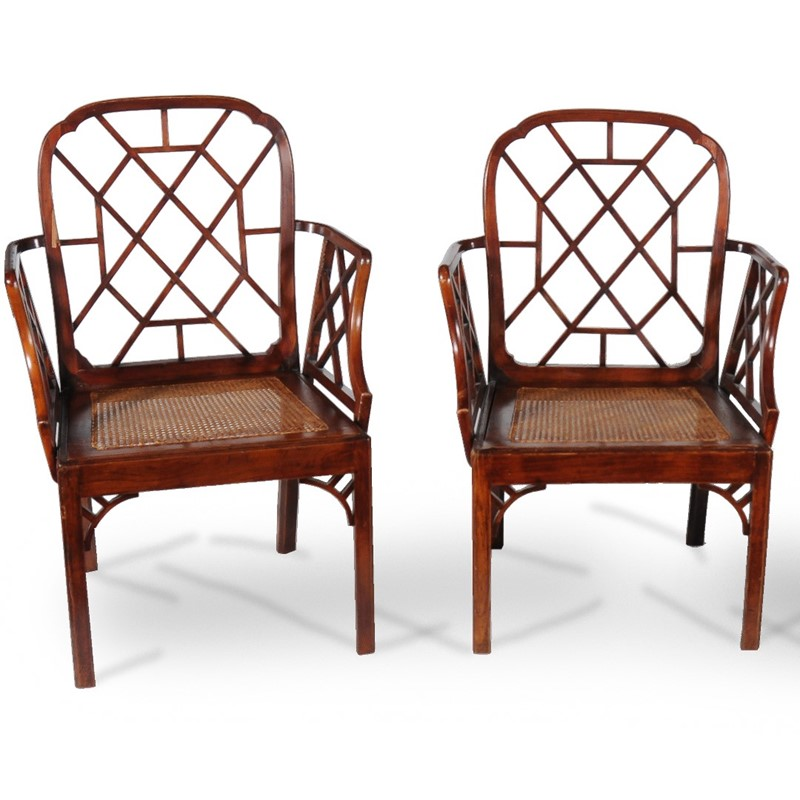 Two of three George III 'cockpen' armchairs, circa 1800, in the 'Chinese Chippendale' taste
