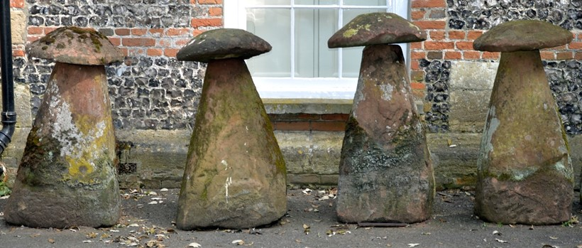 Inline Image - A group of four substantial rough hewn red sandstone staddle stones and caps; sold for £1,984