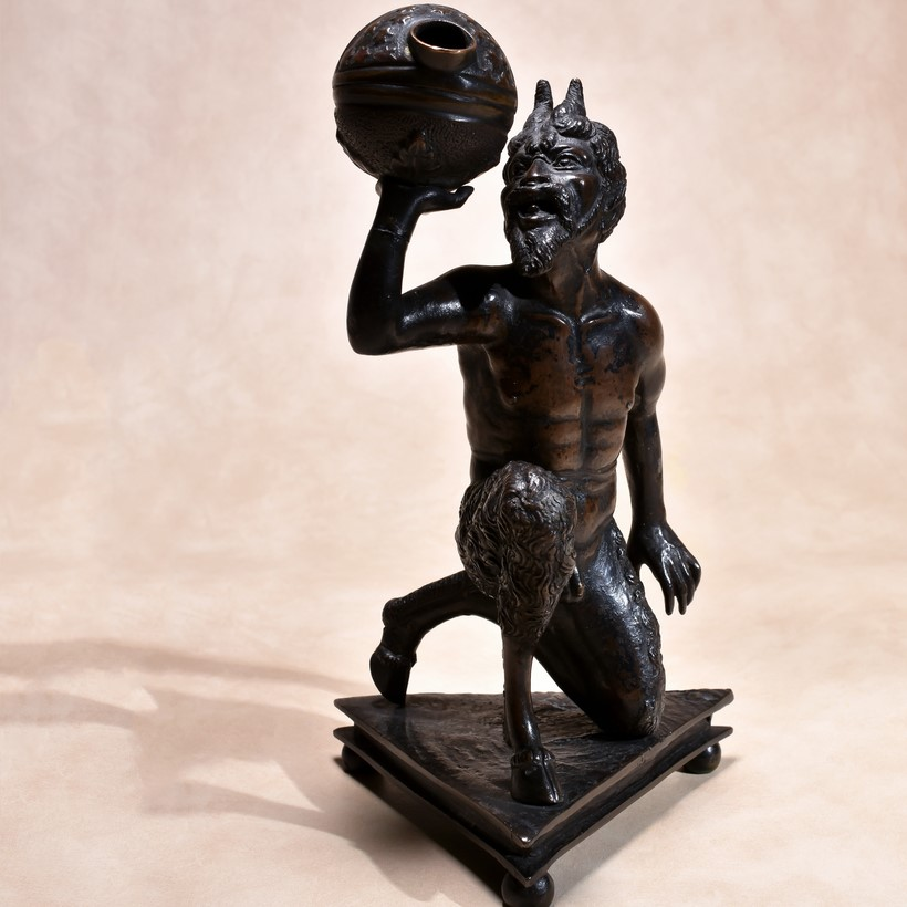 Inline Image - Attributed to Severo Calzetta da Ravenna (active circa 1496-+1543), Italian, Padua, A bronze model of a kneeling satyr mounted as an oil lamp; sold for £9,920
