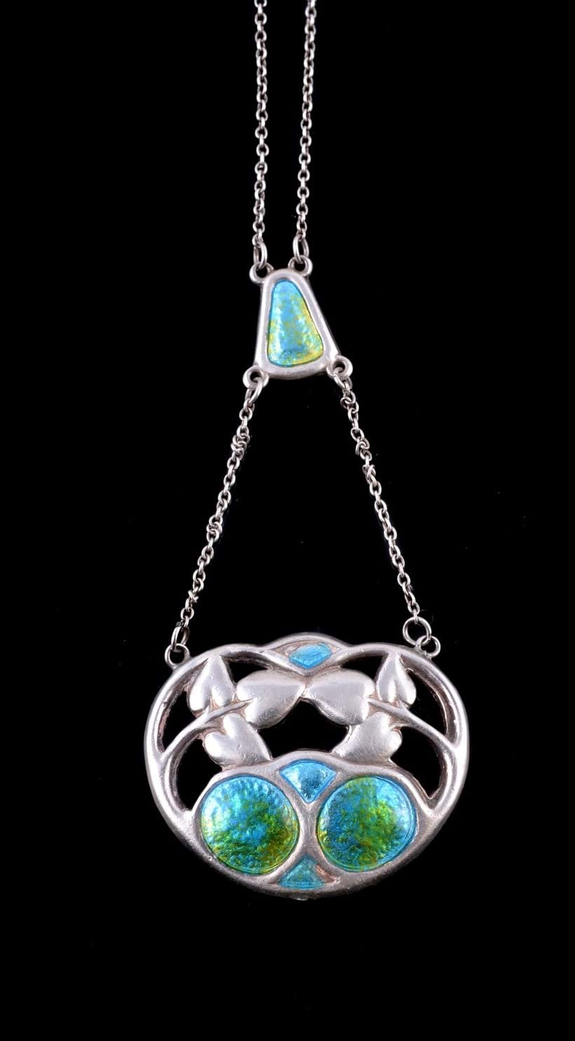Inline Image - Lot 479, Arts & Crafts silver and enamel pendant by Charles Horner, Chester, 1909, the openwork foliate panel with green and blue enamel detail, with full Chester hallmarks, maker's mark CH, on a belcher chain; est. £80-120 (+fees)