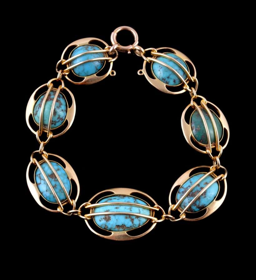 Inline Image - Lot 220, Arts & Crafts turquoise bracelet, by Mürrle Bennett, circa 1905, graduating turquoise in caged settings, stamped 15ct., maker's mark for Murrle Bennett & Co.; est. £500-700 (+fees)