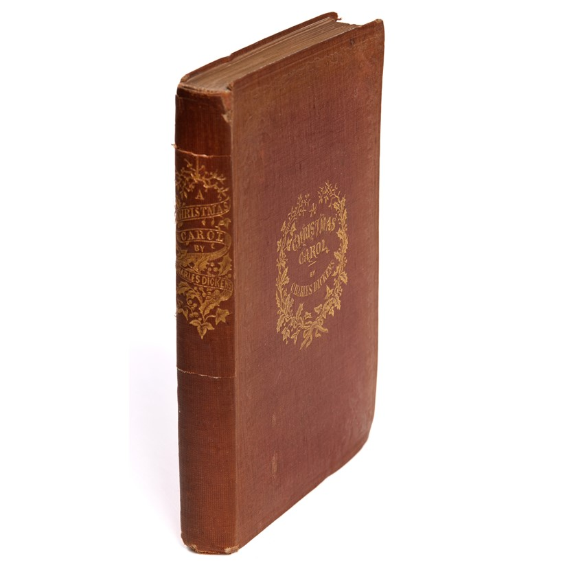 Inline Image - Charles Dickens, A Christmas Carol | first edition, later issue with 'Stave One' | title printed in red and blue, original cloth | Chapman and Hall, London, 1843 | est. £600-800, sold for £1,736