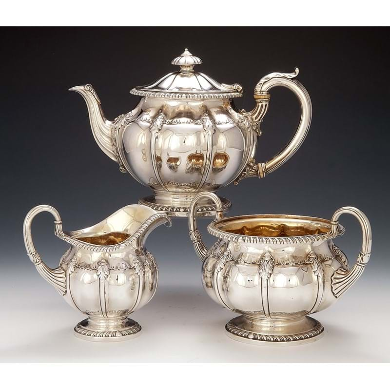 A George IV silver three piece tea service by Paul Storr, London 1822 and 1823