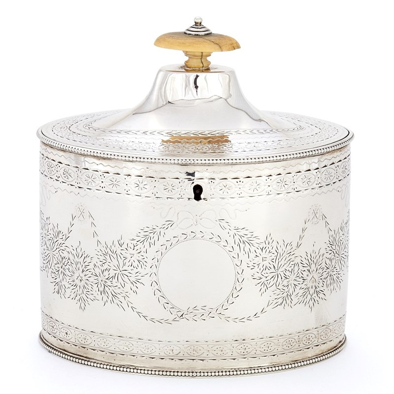A George III silver straight-sided oval tea caddy by Charles Chesterman II