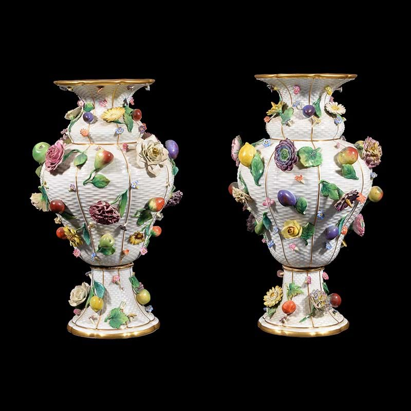 A pair of Meissen (outside decorated) flower and fruit encrusted ozier-moulded baluster vases