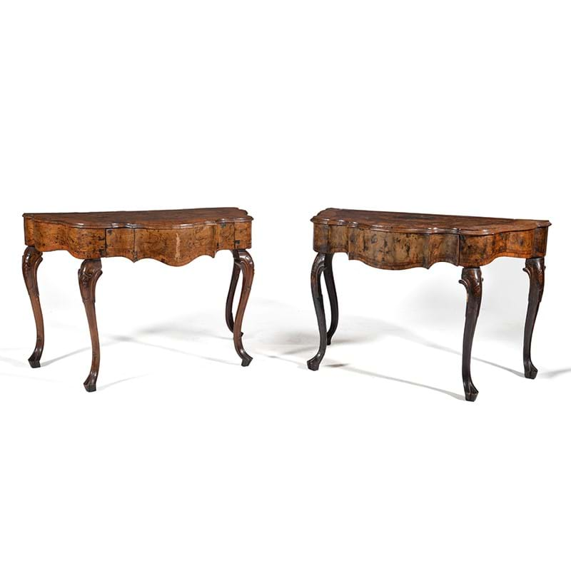 A near pair of North Italian walnut and olivewood serpentine side tables, mid 18th century