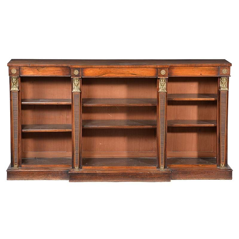 A rosewood and gilt metal mounted open bookcase in Egyptian Revival taste