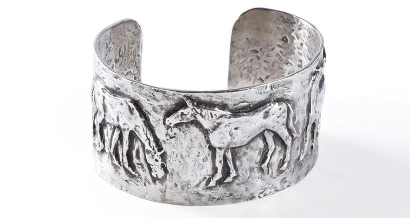 Inline Image - Lot 15 Philip Blacker Horses A sterling silver bangle The five horses in low relief, hallmarked and inscribed PB 7cm wide, 3.5cm high Similar works by this artist retail at: £400