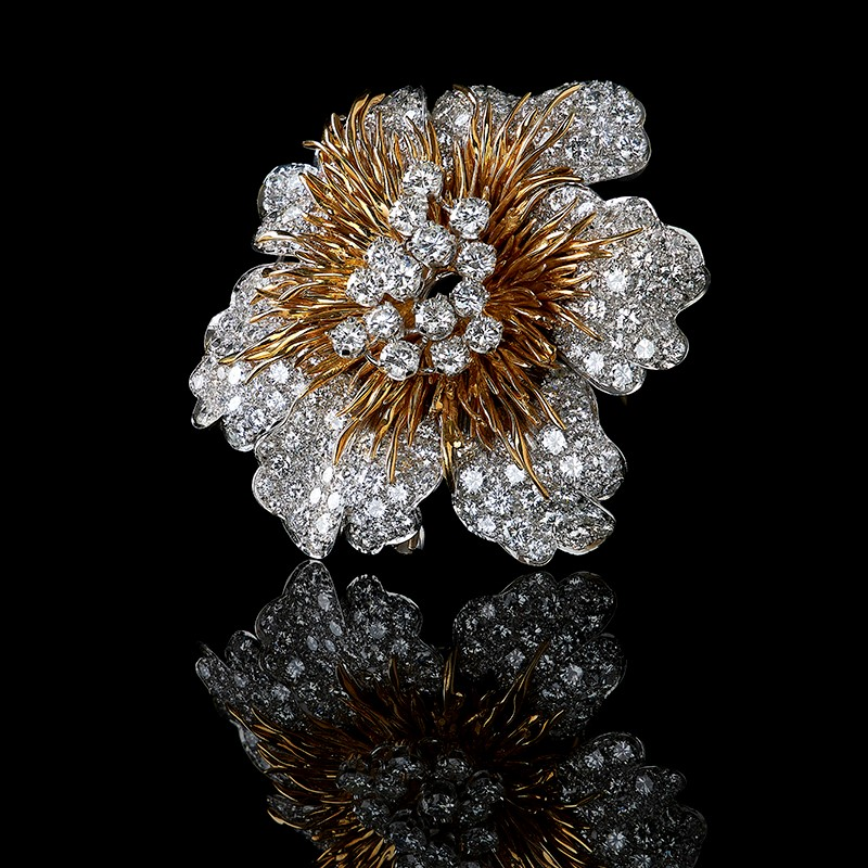 A 1970s 18 carat gold and diamond flower head brooch by Kutchinsky