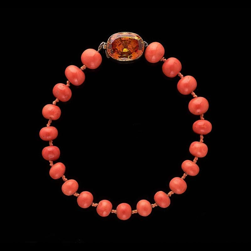 A mid 19th century golden topaz clasp with coral necklace