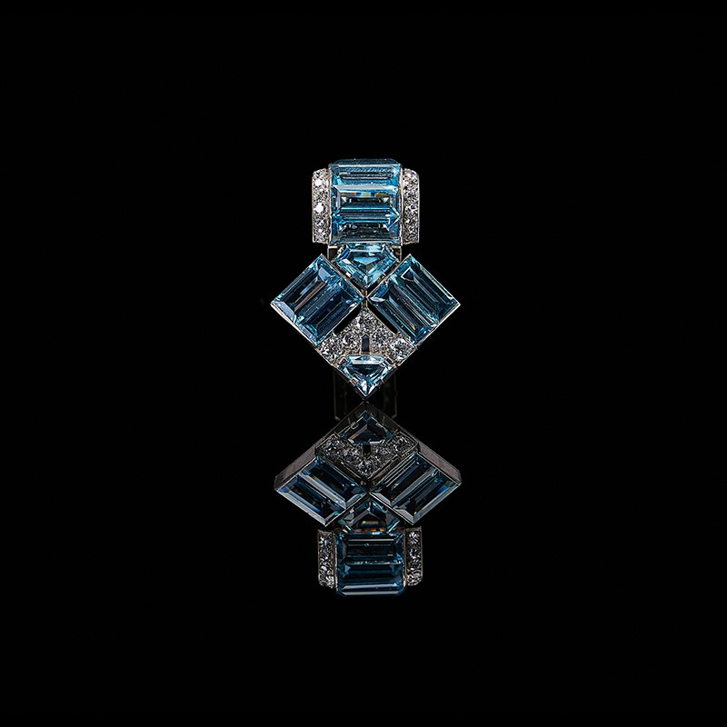 An Art Deco aquamarine and diamond clip by Cartier London, circa 1935