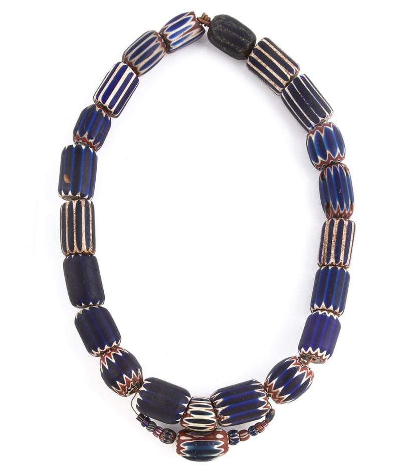Inline Image - A chevron glass bead necklace, composed of blue, red and white chevron glass beads, of varied size, 27cm long, with three loose chevron beads