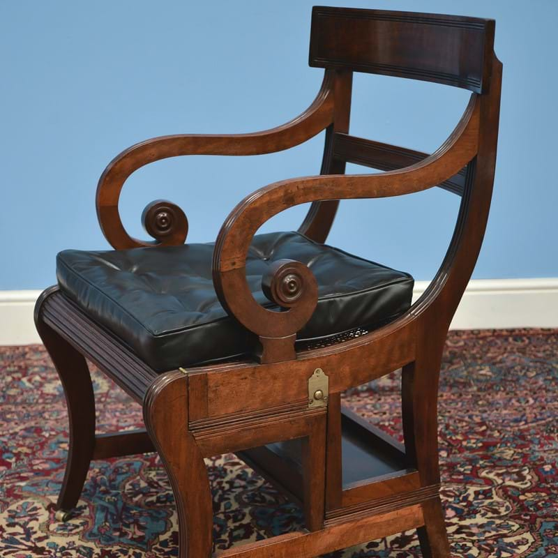 A Regency mahogany metamorphic library chair, supplied by Thomas Weeks consigned to auction