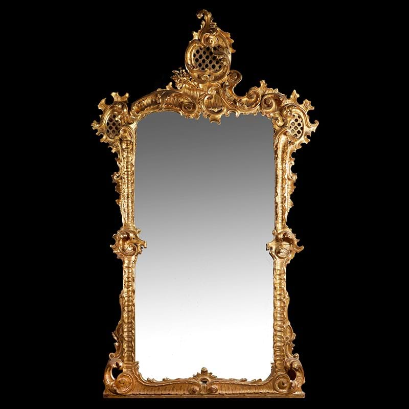 A pair of carved gilt wood overmantel wall mirrors, in Roccoco Revival taste, mid 19th century