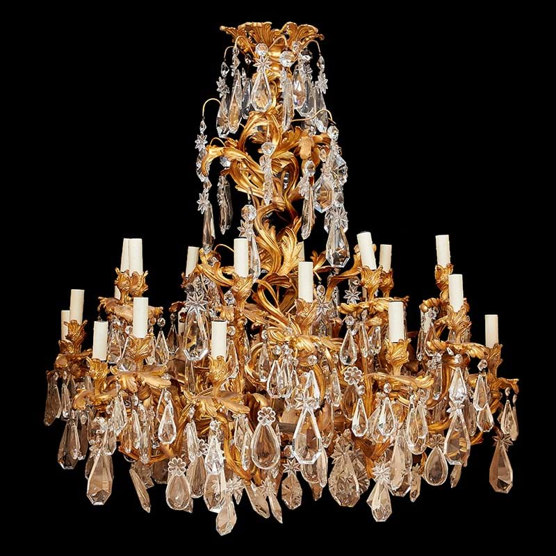 A fine French gilt bronze and cut glass hung twenty four light chandelier in Louis XV style, later 19th century
