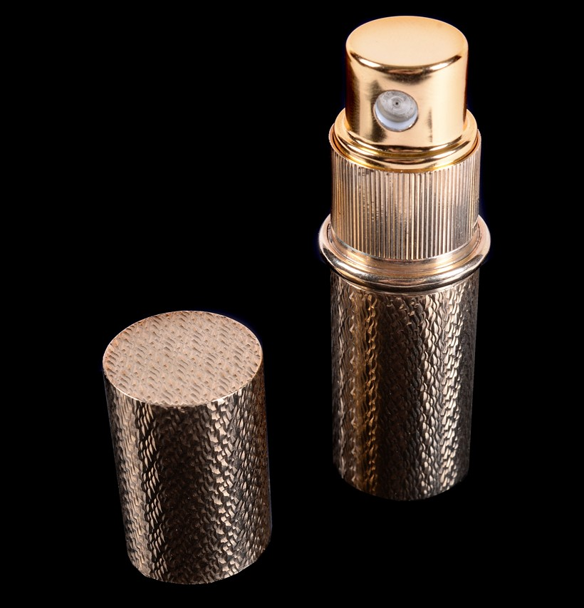 Inline Image - Lot 134: A 1960s 9 carat gold perfume atomiser by Kurt Weiss. Property from the estate of the late Betty, Lady Grantchester | Est. £250-350 (+fees)