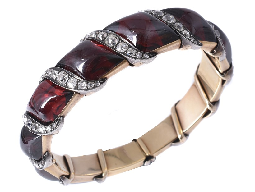 Inline Image - Lot 142: A mid 19th century garnet and diamond bangle, circa 1860 | Est. £2,500-3,500 (+fees)