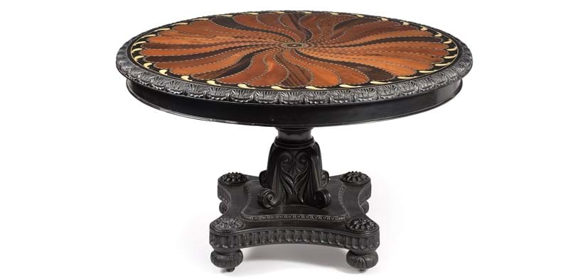 Inline Image - Lot 178: A Ceylonese ebony and specimen wood inlaid circular centre table, second quarter 19th century, probably Ceylonese | Est. £5,000-10,000 (+fees)