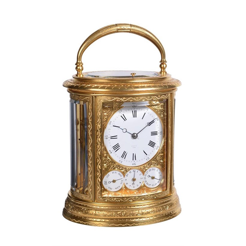 Inline Image - Lot 99: A fine engraved gilt brass oval grande-sonnerie striking calendar carriage clock with push-button repeat and alarm, Drocourt, Paris for retail by Tiffany and Company, third quarter of the 19th century | Est. £4,000-6,000 (+fees)