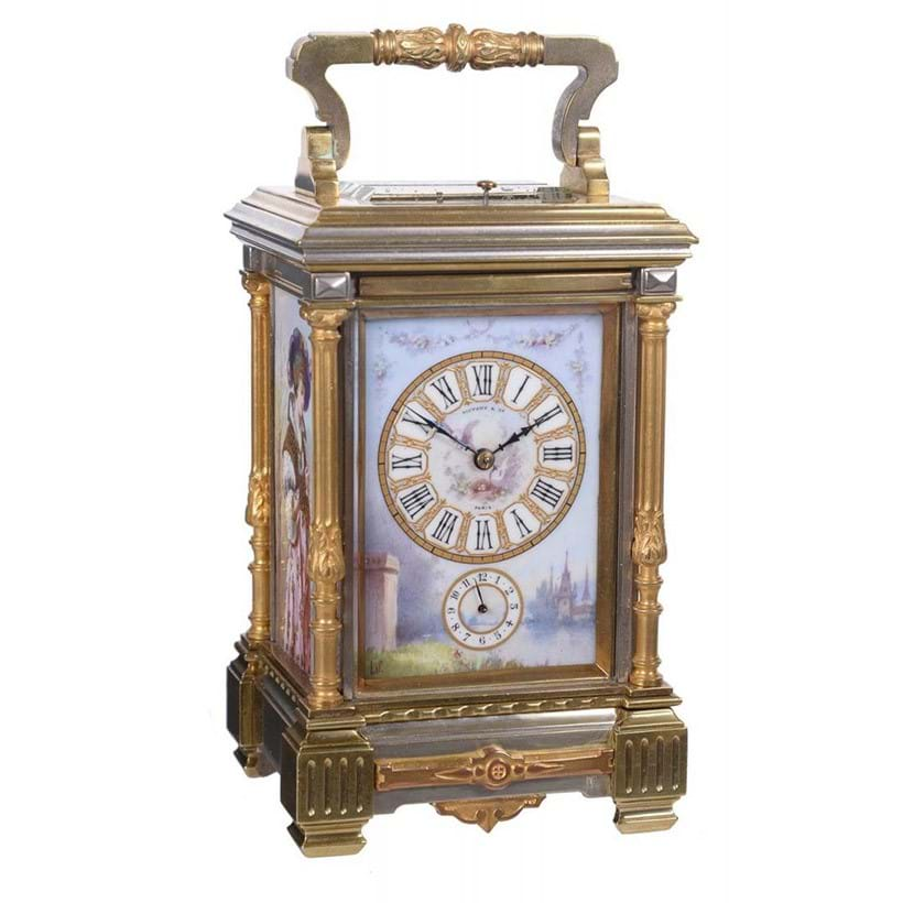 Inline Image - Lot 131: A fine French porcelain panel inset silvered and gilt brass grande-sonnerie striking carriage clock with push-button repeat and alarm, Retailed by Tiffany and Company with panels by Lucien Simonnet, Paris late 19th century | Est. £3,000-4,000 (+fees)