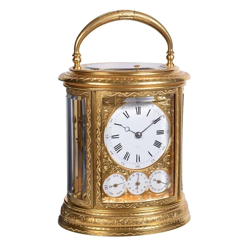 A fine engraved gilt brass oval grande-sonnerie striking calendar carriage clock with push-button repeat and alarm, Drocourt, Paris for retail by Tiffany and Company, third quarter of the 19th century