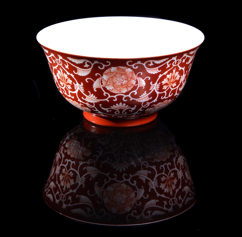 Inline Image - Lot 355: A Chinese coral-ground reserve decorated 'Lotus' bowl, seal mark and period of Qianlong (1735-1796), 13cm diameter | Est. £6,000-8,000 (+fees)