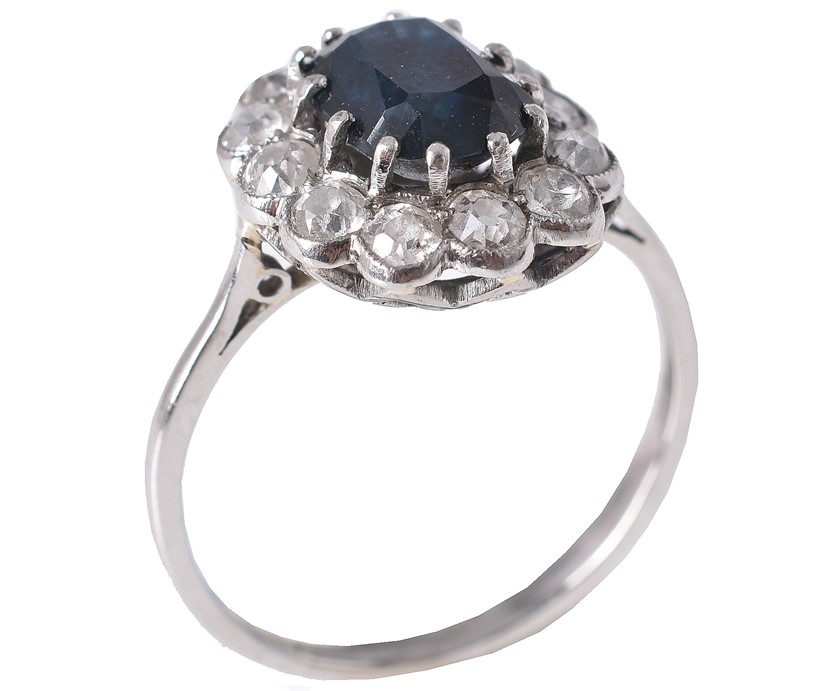 Inline Image - Lot 327: A sapphire and diamond cluster ring, the central oval cut sapphire claw set within a surround of old cut diamonds | Est. £300-500 (+fees)