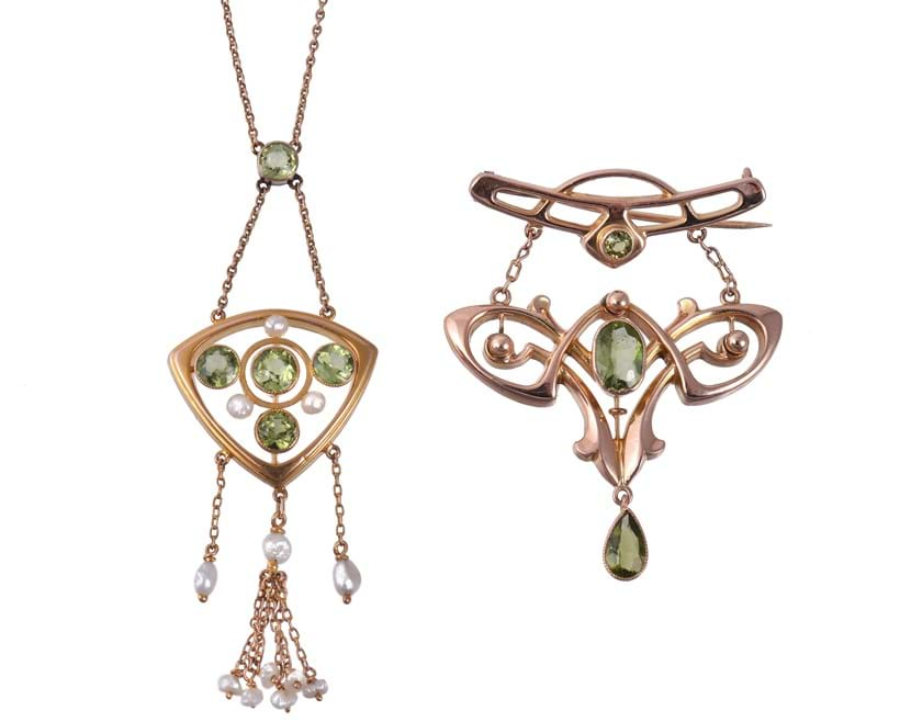 Inline Image - An Arts and Crafts peridot brooch by Liberty & Co., circa 1900, and an Arts and Crafts peridot and freshwater pearl pendant necklace by B. H. Joseph & Co., circa 1900 | Est. £200-300 (+fees), August 2020