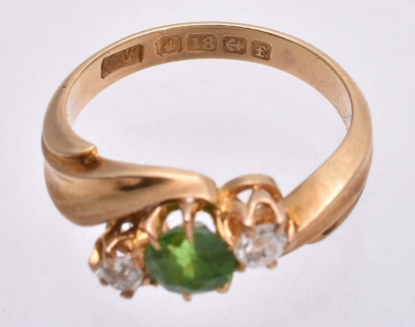 Inline Image - Hallmarks on an Edwardian demantoid garnet and diamond ring (Lot 237 12/8/20) which read: 18 carat gold (the crown and 18 punches), Birmingham Assay Office (The anchor punch) and the date letter f for 1905