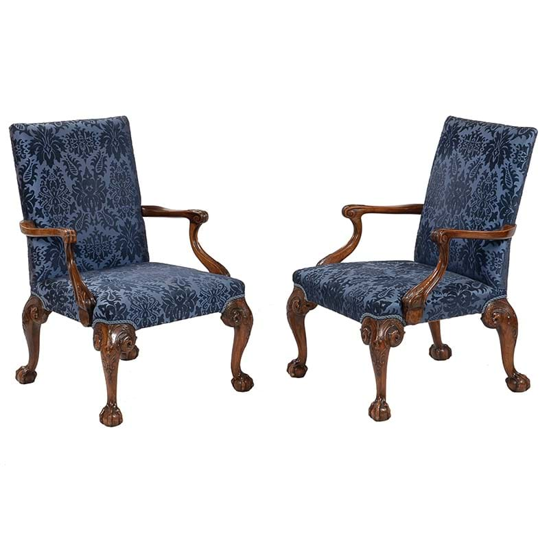 A pair of walnut and upholstered open armchairs, 20th century, in the style of Giles Grendey